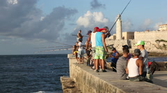 Cuba, Havana, Angler in the Malecon at sunset Stock Footage