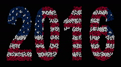 Hands form the text 2016 with colors USA flag on a black background. Stock Footage