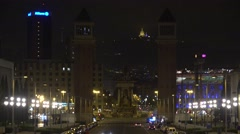 4K Placa Espanya busy public square Venetian towers Barcelona city center night  Stock Footage