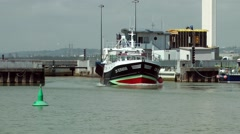 Fishing boat entering port harbour quay Stock Footage