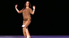 Woman dance on a stage during X International Oriental Dance Festival - stock footage