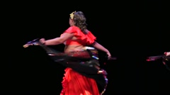 Women dance on a stage during X International Oriental Dance Festival Stock Footage