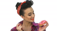 Pin up girl wants to eat yummy - stock footage