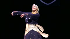 Woman dance on a stage during X International Oriental Dance Festival Stock Footage