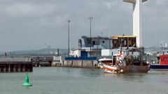Fishing boat leaving port harbour quay industry Stock Footage