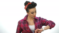 Pin up girl look on wristwatch Stock Footage