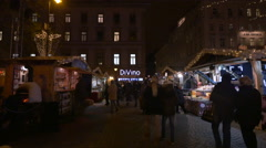 People walking by stalls in Szent Istvan Ter on Christmas in Budapest Stock Footage