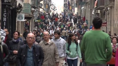 4K Narrow commercial street crowded tourist people Barcelona old town shop sign  Stock Footage