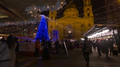 Christmas tree, people ice skating and walking in Szent Istvan Square, Budapest Stock Footage
