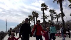 4K Timelapse pedestrian people relax promenade Barceloneta area Barcelona icon  Stock Footage