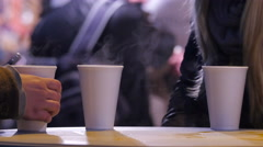 Three steaming cups with mulled wine at the Christmas market in Budapest Stock Footage