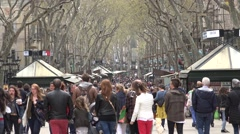 4K Crowded Rambla commercial street Barcelona downtown local shop icon day sign Stock Footage