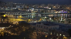 4K Aerial view Port Vell traffic street Barcelona landmark night tourism emblem Stock Footage