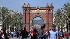 4K Timelapse crowded pedestrian people Barcelona Arc Triomf iconic place daytime Stock Footage