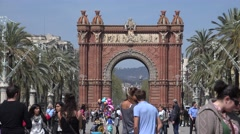 4K Tourist people relax Arc Triomf busy sidewalk Barcelona landmark iconic place Stock Footage