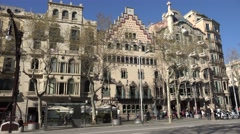 4K Traffic street Amatller building Casa Batllo iconic house Barcelona emblem  Stock Footage