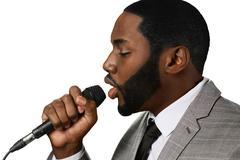 Darkskinned man sings jazz. Stock Photos