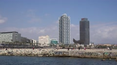 4K Timelapse tourist people visit Barceloneta promenade Barcelona modern tower  Stock Footage