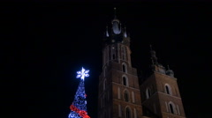 Christmas tree next to the St. Mary's Basilica in Krakow, at night Stock Footage
