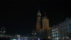 St. Mary's Basilica and the Christmas market in Krakow, at night Stock Footage