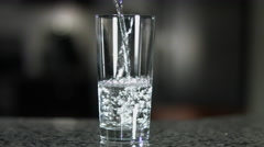 Glass Half Empty or Half Full Pour Slow Motion Stock Footage