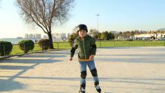Young male skater skating to  camera - stock footage