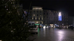 Men walking in Rynek Glowny central square in Krakow, at night Stock Footage
