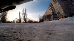 front view of the car riding on snow covered road - stock footage