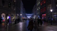 Walking on Grodzka street cross to Rynek Glowny square in Krakow, at night Stock Footage