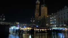 View of the St. Mary's Basilica and the Christmas market in Krakow, at night Stock Footage