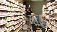 Mother Shopping With Little Boys In Health Food Store - stock footage