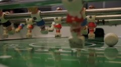 Goal score from other end of foosball table - stock footage