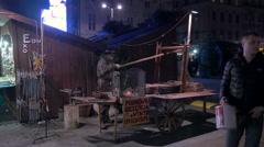 Blacksmith on the Christmas fair in Krakow, at night Stock Footage