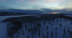 Aerialshot Of White Snow Capped Hill To A River While Sunset. At Polar Circle. Stock Footage