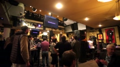 People at the famous Hard Rock Cafe. Stock Footage