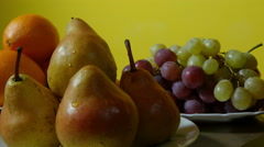 Pears and grapes, close up, dolly shot, fresh fruits on table. - stock footage