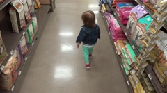 Following jean jacket toddler at pet store thru dry dog food aisle. DENVER, Stock Footage