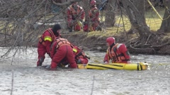 Firefighters Remove Body From River Stock Footage
