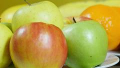 Apples on table, extreme close up,dolly shot,other fruits in background Stock Footage