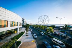 The exterior of the Mall of Asia and ferris wheel, in Pasay, Metro Manila, Th Kuvituskuvat