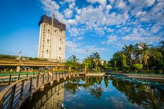 Skyscraper and walkway along a pond at Rizal Park, in Ermita, Manila, The Phi Kuvituskuvat