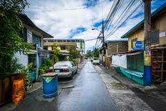 A narrow alley in Poblacion, Makati, Metro Manila, The Philippines. Kuvituskuvat