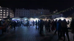 People near stalls with Christmas decorations at the Christmas market in Krakow Stock Footage