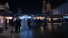 People near street stalls with presents at the Christmas market in Krakow Stock Footage