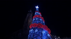 View of the top of a Christmas tree at the Christmas market in Krakow, at night Stock Footage