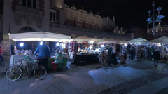 Street stalls near the Clothing Hall at the Christmas market in Krakow, at night Stock Footage