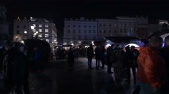 People walking at the Christmas market in Krakow, at night Stock Footage