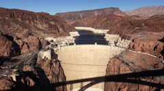 Aerial View of Hoover Dam and Shadow of Bypass Bridge - stock footage