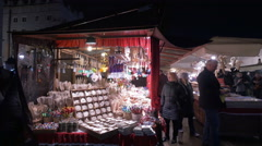 People looking at products from street stalls at the Christmas market in Krakow Stock Footage