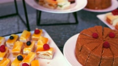 catering buffet with cakes. - stock footage